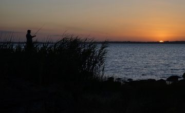 Photo of a fisher at Lake Burrumbeet at sunset